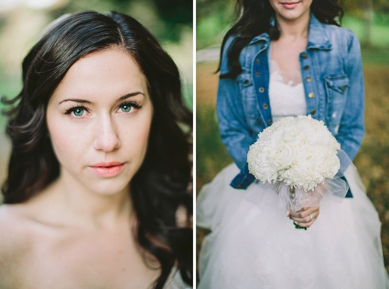 a bride with a jean jacket and bouquet