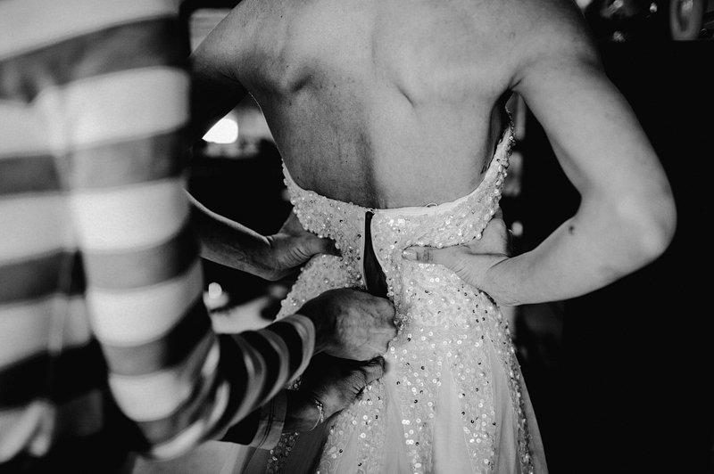 bride puts on dress catskills 2