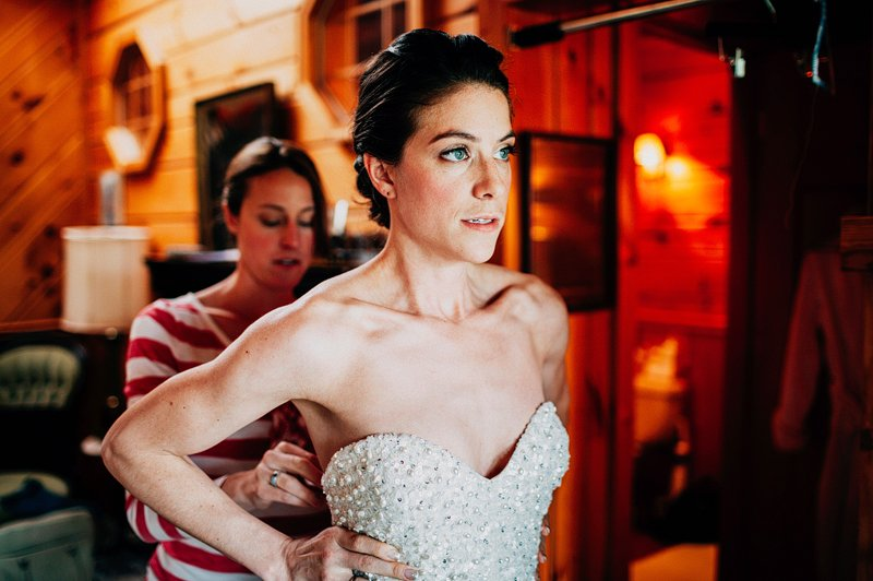 bride puts on dress catskills