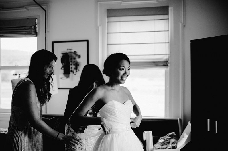 bride getting dress on roxbury bed and breakfast 3