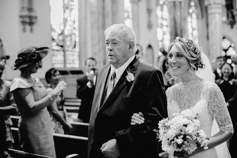 bride walks down the aisle with grandfather